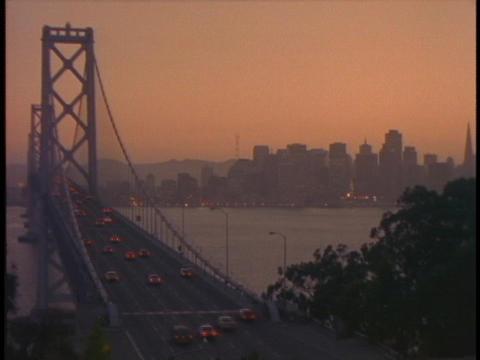 Traffic drives across the Bay Bridge toward San Francisco Stock Video Footage