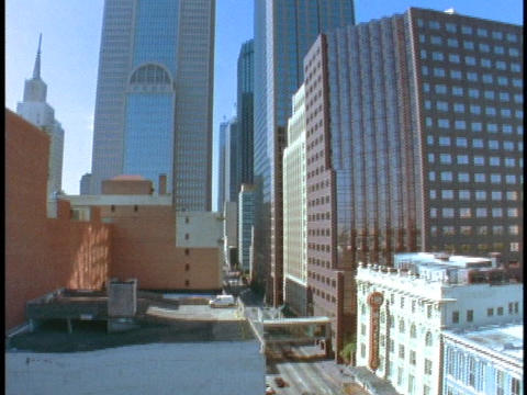 Skyscrapers tower over a city street in Dallas Footage