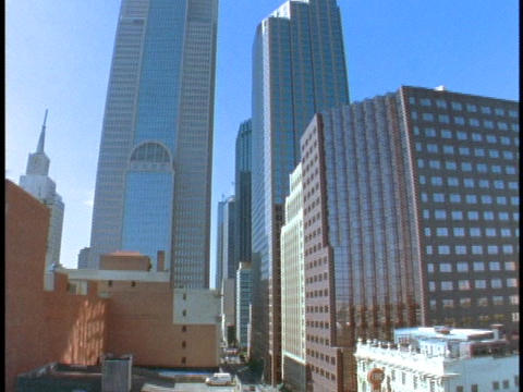 Skyscrapers tower over a city street in Dallas Stock Video Footage