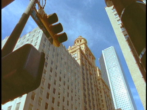 Skyscrapers tower over a traffic light in Houston Stock Video Footage