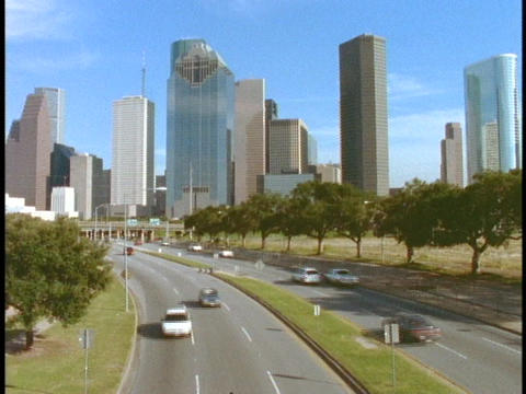 A freeway leads into downtown Houston Stock Video Footage
