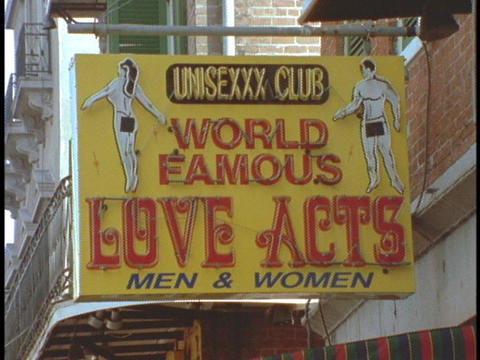 A sign for a sex parlor hangs from a building in New Orleans Stock Video Footage