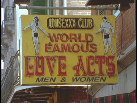 A sign for a sex parlor hangs from a building in New Orleans Footage