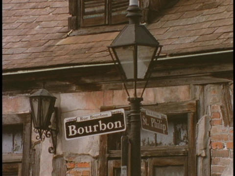 A Bourbon street sign hangs on a lamppost Footage