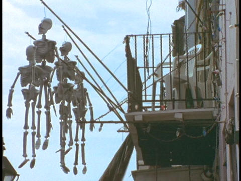 Skeletons hang from the balcony of a building in the... Stock Video Footage