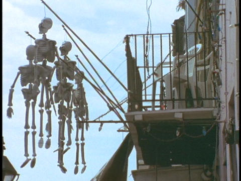 Skeletons hang from the balcony of a building in the French Quarter of New Orleans Footage