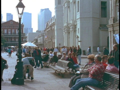 Tourists wander around the French Quarter of New Orleans Stock Video Footage