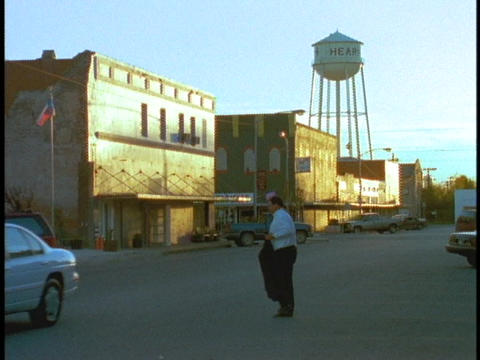 A water tower rises above a small town Stock Video Footage