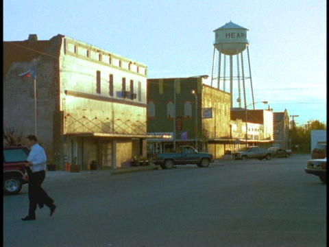 A water tower rises above a small town Footage