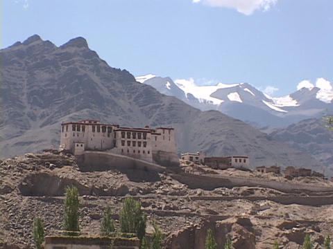 A Buddhist monastery nestles in the mountains Stock Video Footage