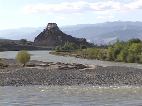 The Indus River flows beneath a Buddhist monastery Stock Video Footage