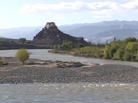 The Indus River flows beneath a Buddhist monastery Footage
