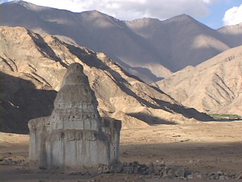 A Buddhist stupa sits in the shadow of the Himalayas Stock Video Footage