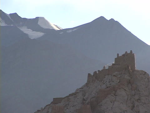 A palace sits on a mountaintop in the Himalayas Stock Video Footage