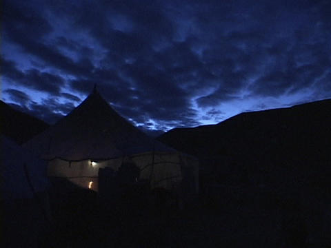 A fire burns inside a tent in the Himalayas Stock Video Footage