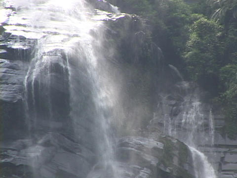 Water pours over a cliff Stock Video Footage