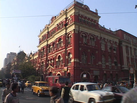Traffic drives past colonial buildings Stock Video Footage