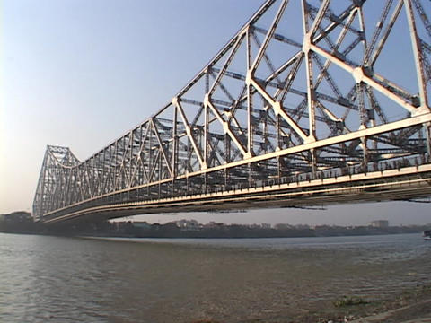 Howrah Bridge spans a river in Calcutta, India Stock Video Footage