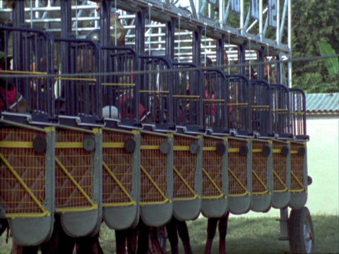 Horses leave the gate during a horse race Stock Video Footage