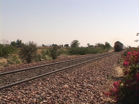 A passenger train moves along the train tracks Stock Video Footage