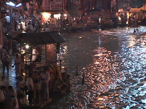 Hindu pilgrims gather on the banks of the Ganges River Stock Video Footage