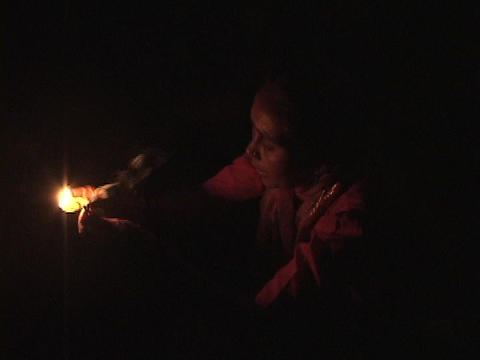 A Hindu woman prays by candlelight Footage