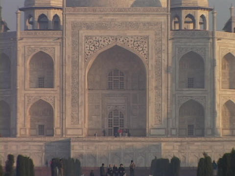 A pool of water reflects the Taj Mahal Stock Video Footage