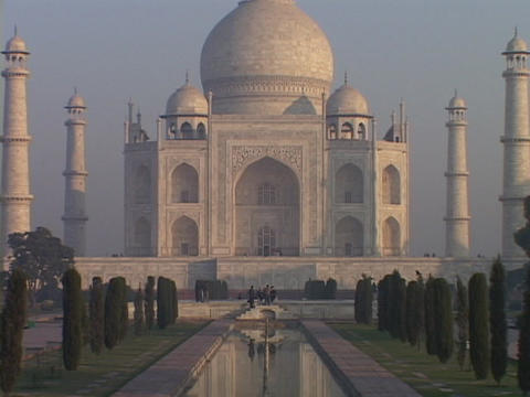 A pool of water reflects the Taj Mahal Footage