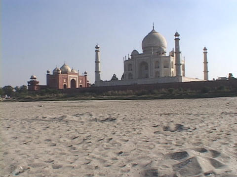 A desert leads up to the Taj Mahal Footage