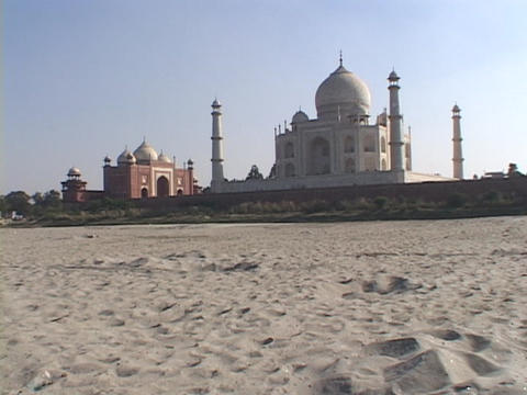 A desert leads up to the Taj Mahal Stock Video Footage