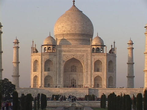 People walk in front of the Taj Mahal Stock Video Footage