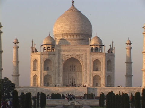 People walk in front of the Taj Mahal Stock Video Footage