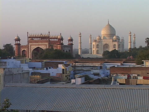 The Taj Mahal rises above the rooftops of Agra, India Footage