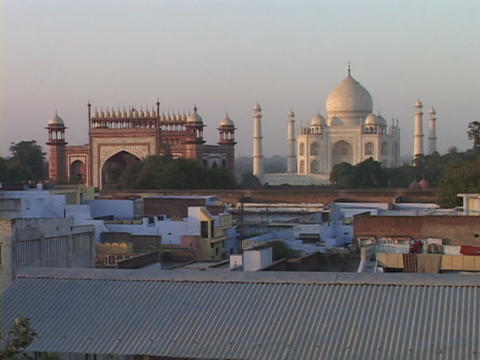 The Taj Mahal rises above the rooftops of Agra, India Stock Video Footage
