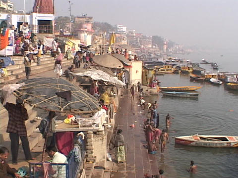 People bathe in the Ganges river Footage
