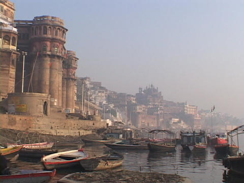 Boats float idly on the Ganges River Stock Video Footage