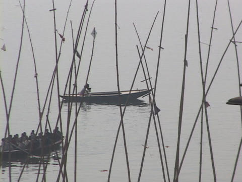 Oarsmen row their boats along the Ganges River Stock Video Footage
