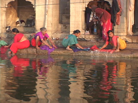 Women wash clothes in the Ganges River Stock Video Footage