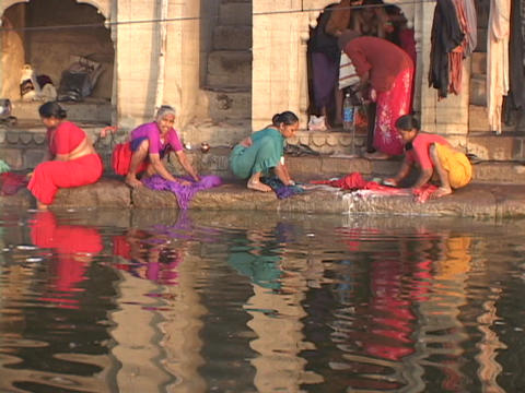 Women wash clothes in the Ganges River Footage