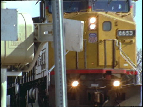 A freight train travels along a track Stock Video Footage