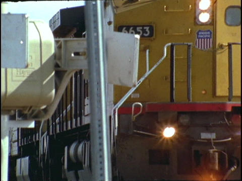 A freight train travels along a track Footage