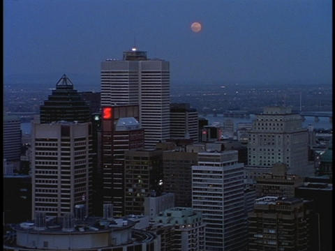 A light spins on the top of a skyscraper in Montreal Stock Video Footage