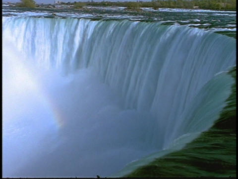Water cascades down Niagara Falls Stock Video Footage