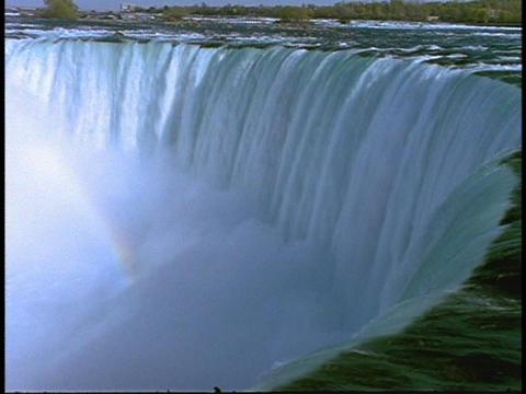 Water cascades down Niagara Falls Footage