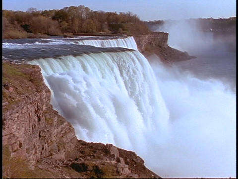 Water cascades over Niagara Falls Stock Video Footage