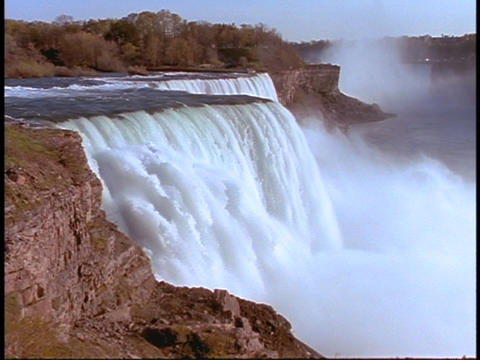Water cascades over Niagara Falls Stock Video Footage