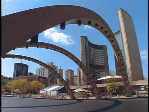 Steel arches span a city street in Toronto Stock Video Footage