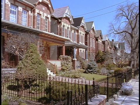 Identical duplexes line a suburban neighborhood in Toronto Stock Video Footage