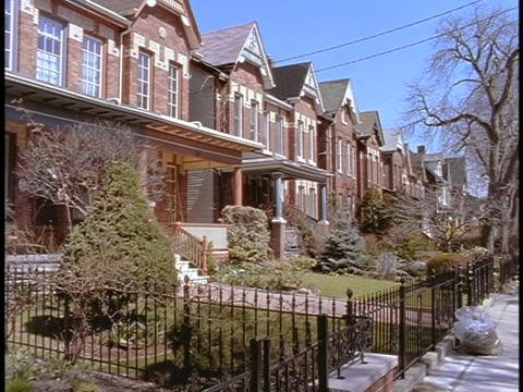 Identical duplexes line a suburban neighborhood in Toronto Footage