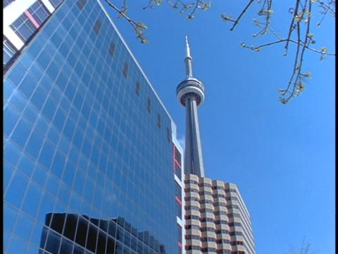 A Building Beside The CN Tower In Toronto Reflects Another Building stock footage
